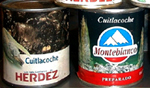 "Figure 29. (a, left) Cans of cuitlacoche processed and sold in Mexico. (b, right) A growing market for cuitlacoche among English-speaking consumers is evident from recent label changes which include identification of the fungus as ""maize mushrooms"". (Courtesy J.K. Pataky)"