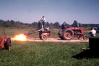 Figure 30. Flame killing of potato vines before harvest. (Courtesy H. D. Thurston)